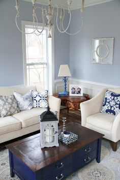 Taupe sofa with navy ivory rug living room theme - Ivory painted living room furniture ...