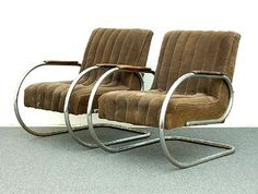 Two tubular steel fauteuils with brown upholstery and painted wooden armrests design execution unknown ca.1935