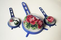 Cross stitch on vintage colanders
