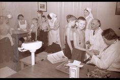 "1943, Sagene, Oslo. ""Barnereiser"". Kids from Oslo recieving a medical examination before being sent to the countryside for ""fattening up"". Oslobilder"
