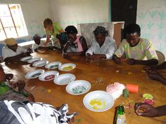 Widows at the Widow Care Center in Kenya beading bracelets.