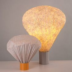 I am loving these lamps. Great to soften and add elegance to a space. Pleated Vapeur Lamps by Inga Sempé
