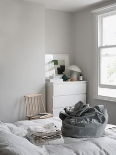 Light Scandi style bedroom with French linen bedding. How to care for your bed linen, with eco-friendly dry cleaners BLANC London [AD]