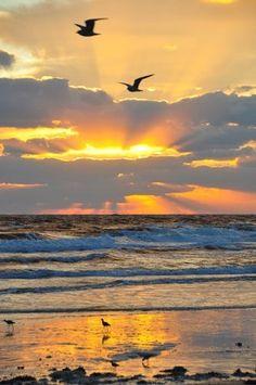 zee, zon en wolkenspel