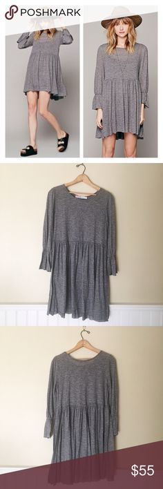 ✨🆕 Free People l Beach Jess Striped Dress Super cute and comfy dress by Free People. In a breezy babydoll silhouette with bell sleeves. The dress is an olive and shadow grey alternating stripe pattern. The last stock photos are just to show fit! Worn minimally and in excellent condition. Free People Dresses