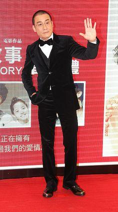 Hong Kong actor Tony Leung Ka-fai waves at a premiere of his new movie 'Beijing Love Story' in Hong Kong, China, March 10, 2014