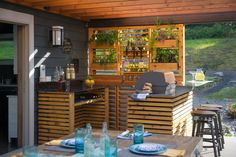 Layers of warm color and textures, like cedar and steel are incorporated throughout the bar area and vertical garden.