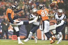 Denver Broncos punter Britton Colquitt (4) punts while Vigil Green blocks on against the New England Patriots. Both players have faith in Jesus Christ.