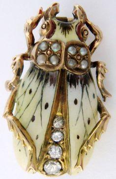 larameeee:    Antique Art Nouveau pearl, enamel, and diamond beetle pin, circa 1900. Via Diamonds in the Library.
