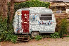 This Tiny Trailer Rustic Photography was taken in a little Welsh Village or Llangollen, in the relatively small country of Wales. Nestled in with some vines, next to an old workshop, this uniquely pai
