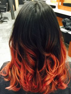 Apollymi's hair is a mix between all ranges reds, yellows, blacks, oranges, and…