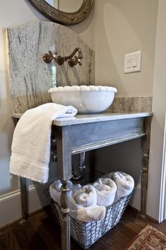 Claw foot tub, chalk-painted vanity, and much more to see in this small guest bath.