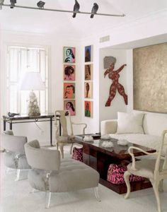 ART DECO CHIC!  Contemporary art makes this white living room stand out.