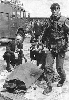 Victim gets emergency treatment following a Provisional IRA car bomb in Oxford Street, Belfast, N Ireland. One civilian died in the blast. 2...