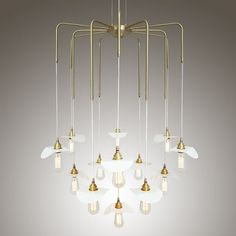 Featuring a sophisticated design, the Madaba Chandelier was designed for impact and is a wonderful centerpiece in dining and seating areas. This contemporary chandelier provides multi-directional coverage to infuse any room with a comprehensive glow. #chandelier #ceilinglight #contemporarychandelier #lighting #largechandelier