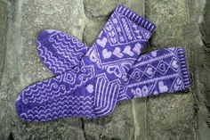 This stranded sock pattern features a heart motif that changes throughout the pattern and a customizable foot length.