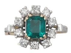 '0.84ct Emerald & Diamond Cluster Ring - Vintage' http://www.acsilver.co.uk/shop/pc/0-84-ct-Emerald-and-0-50-ct-Diamond-18-ct-Yellow-Gold-Cluster-Ring-Vintage-Circa-1970-35p6287.htm
