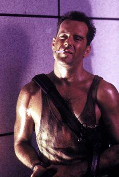 """Bruce Willis as Officer John McClane in """"Die Hard"""" (1988)"""