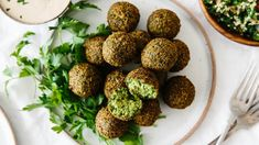 Falafel are delicious balls of chickpea goodness that are vegan and vegetarian. They're great in wraps, pitas, sandwiches and salads! Comida Israeli, Israeli Food, Israeli Salad, Korma, Biryani, Food Menu, A Food, Catering Food, Best Falafel Recipe