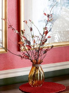 Paper Leaves Centerpiece  Revive bare branches with paper leaves. Pick paper scraps that match your Thanksgiving decor. Fold paper scraps in half and cut out leaf shapes using scallop-edge scissors. Hot-glue the leaves to the branches, along with dried or artificial berries.