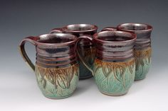 """""""Carved Leaf Mugs"""" in green and plum by Sylvia Coppola of Duck Creek Pottery. American Made. Kitchenware, Tableware, Tea Bowls, Best Coffee, Handmade Pottery, Ceramic Mugs, American Made, Tumbler, Tea Cups"""