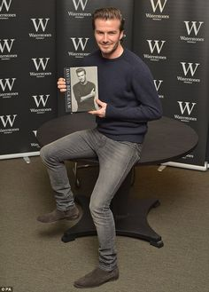 David Beckham poses with his self-titled autobiography at his only book signing in London