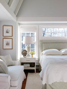 Reflective colors and fabrics make the master bedroom light and airy.