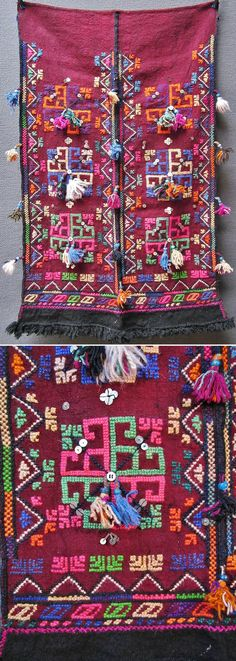 Traditional woollen apron from the Dursunbey area (80 km east of Balıkesir), ca. mid-20th century.  Adorned with embroidered motifs (wool and orlon), small tassels, glass beads, white buttons and metal sequins.  The lower edge features  row of black wool fringes.  (Inv.n° önL057 - Kavak Costume Collection -Antwerpen/Belgium).