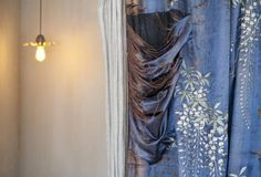 The dressing room features a vintage silk embroidered curtain