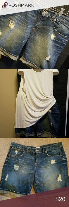 "Trendy Gap Jean Shorts Srylish distressed denim shorts. Trendy rips & rolled cuffs. Good stretch & quality denim. 14/32 Boyfriend 18.5""  waist 20"" hips  18"" long 100% COTTON   **TOP FOR SALE IN CLOSET XL/XXL GAP Shorts Jean Shorts"