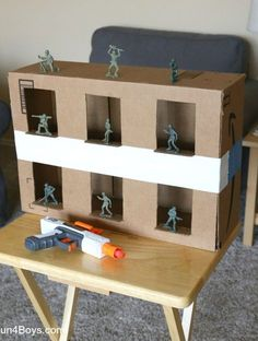 Nerf Gun Game: Army Guy Shootout Turn a cardboard box into an army guy shooting gallery for Nerf guns! Plastic army guys are a great target to shoot. They're fun to knock over, and the price is definitely right! In general, we prefer to use Nerf targets Projects For Kids, Diy For Kids, Crafts For Kids, Guy Crafts, Summer Fun For Kids, Nerf Gun Games, Nerf Birthday Party, 9th Birthday Party Ideas For Boys, Wine Birthday