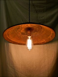 Primitive Rustic Pendant Light, Exposed Edison Bulb and Cloth Wiring, Minimalist. $75.00, via Etsy.