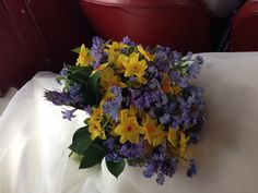 Spring bouquet, daffodils, forget me nots, blue bells. Wedding vintage