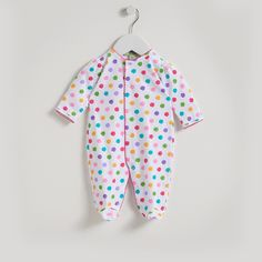 A sweet colourful footiefor baby girl by Kissy Kissy. Made from 100% Peruvian pima cotton for softness and comfort. Colourful polka dots. Popper fastening down the front. It's perfect foreveryday wear. Complete the look with matching items from Kissy Kissy's QT Paintbrush Dots range.