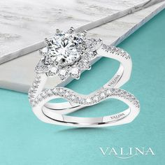 Symbolize a love that embraces you with warmth and happiness just like the sun with this beautiful halo engagement ring.#Valina #diamonds #bridaltrends #perfectwedding #wedding2021 #2021weddings #engagementringideas #diamondrings #bridalcouture #engagementrings #whitegold #straightengagementring #whitegoldengagementring #Isaidyes #enagagementringgoals #diamondsareagirlsbestfriend #statementring #statementengagementring #bridalset #haloengagementring #engagementringinspiration