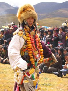 Dabpa, Kham, Tibet. Local tibetan guy dressed up in authentic local traditional costume at a horse. These costumes and their constituent ornaments are family heirlooms. Eastern Tibet (Kham and Amdo) has some of the most ornate ornaments and jewelry in Tibet, as well as the most spectacular displays of personal adornment at traditional festivals like horse races and weddings.