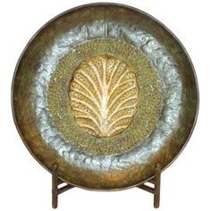 """Metal plate with leaf detail and stand.   Product: Plate with standConstruction Material: MetalColor: Rusty greenDimensions: 22"""" H x 20.5"""" W x 5.5"""" D"""