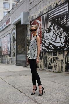 Black skinnys. White and black polka dots top.