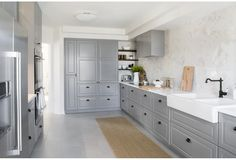 Who says the kitchen has to be white? Soft greys work to open the room while adding a modern appeal.