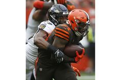 5f1a82249 Cleveland Browns running back Carlos Hyde (34) is tackled by Baltimore  Ravens linebacker Matt