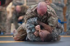 Sgt. 1st Class. Elijah Howlett grapples with Spc. Kendrick Jones during a tournament held as the final event of U.S. Army Europe?s 2015 European Best Warrior Competition, Friday, Sept. 18, 2015. Howlett would go on to win top honors as the best noncommissioned officer in USAREUR. (Michael Darnell/Stars and Stripes)