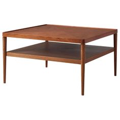 IKEA STOCKHOLM Coffee table - golden brown - $179 Something about this mid-century modern inspired table I love, and might make the red tones make more sense?