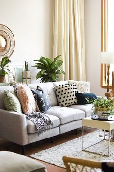 Gorgeous Gray Modern Burrow Modular Sofa styled in a boho midwestern chic living room