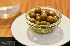 Herb-marinated Arbequina olives at El Tap i Altres Terres in Valencia, Spain