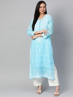 Ada Hand Embroidered Blue Kota Lucknowi Chikan Kurti With Slip- A100534 is enhanced with dense embroidered neck and motifs are placed on the rest of the part #Adachikan #chikankari #handembroidery #chikan #shoponline #lucknowi
