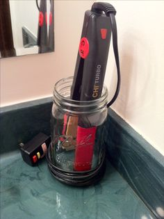 Flat iron storage in mason jar. Lets you keep the cord out of the kiddos reach while your flat iron cools!  I never have time to let my flat iron cool and then put it away!!