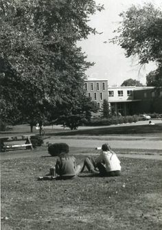 Students on the lawn with a view of the Library from the current site  of the Merck building