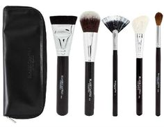 The set contains one each of: 1.) The F25 Large Powder/Bronzer Brush.  2.) The F20 Flat Buffer Brush.  3.) The F05 Fan Brush.  4.) The F28 Fluffy Powder Brush.  5.) The F04 Angled Blush Brush.