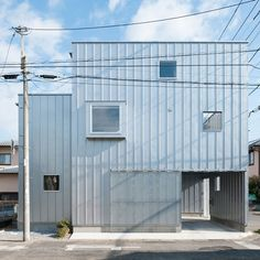 Love! Like! Share! House in Chiba by Yuji Kimura hides a garage and balcony behind its walls