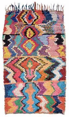 rag rug, wish I knew how to make something like this.